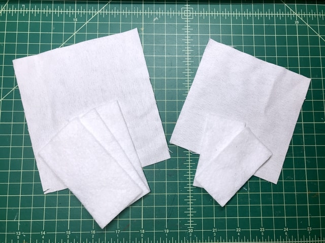 pieces of batting and white flannel fabrics for making miniature mattress