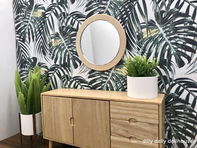 miniature wood mirror frame on wallpaper