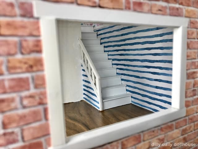 brio dollhouse stripes wallpaper at stairs area