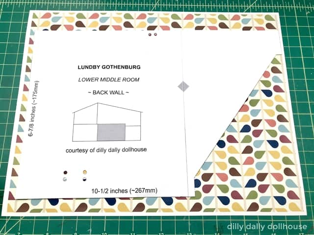 Lundby dollhouse wallpaper template being traced onto patterned paper