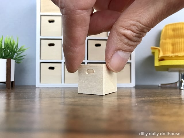 miniature wooden box held by hand
