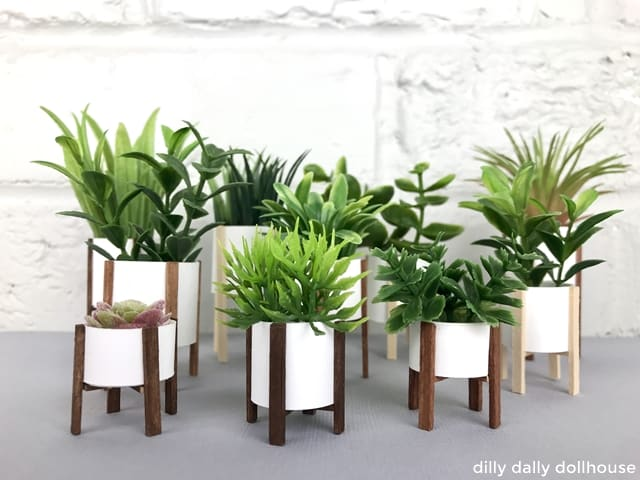 a group of handmade modern dollhouse planters