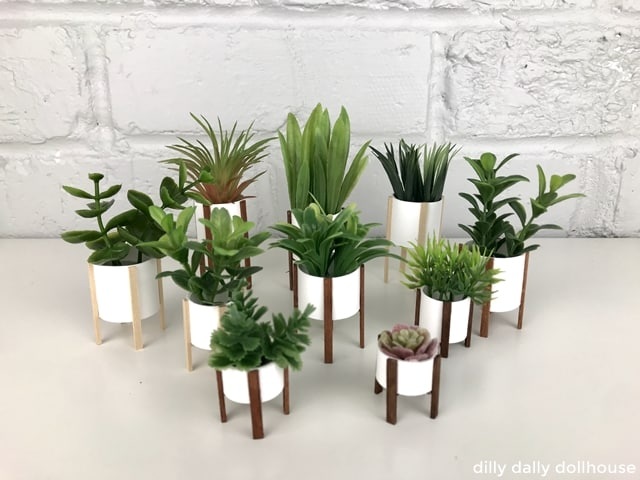a group of modern dollhouse planters