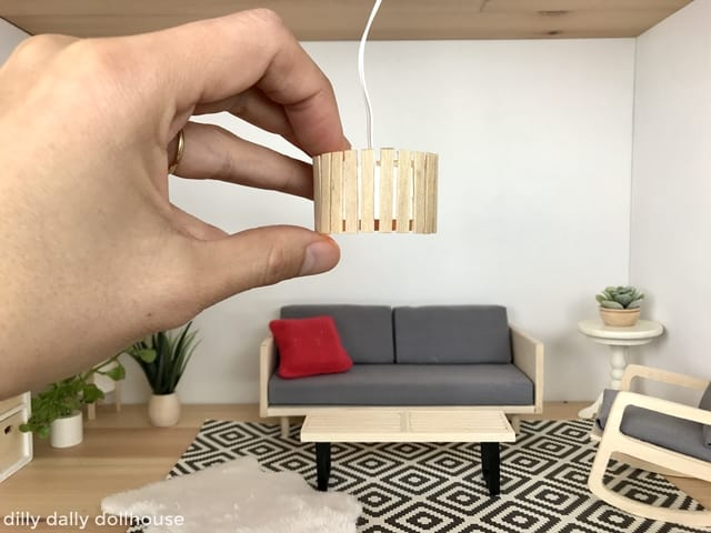 miniature ceiling light held by hand
