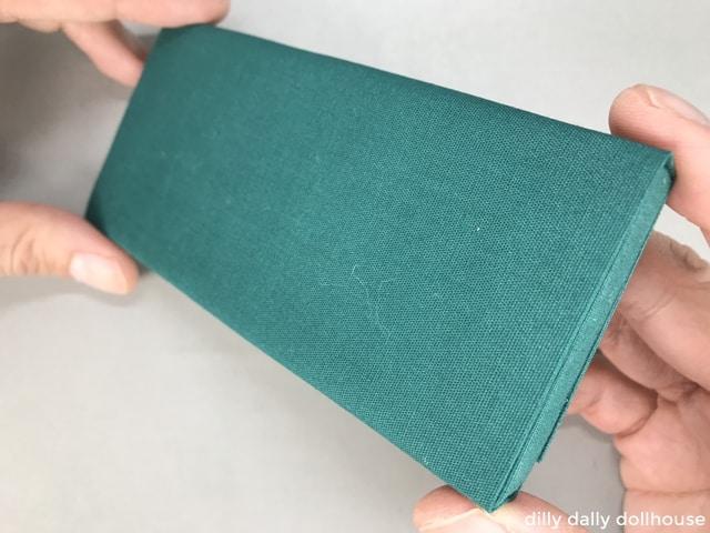 fabric wrapped around foam core to make sofa cushion