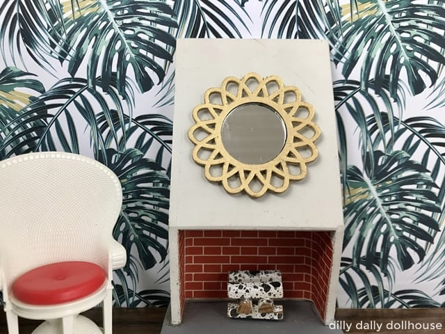 miniature gold starburst mirror on a fireplace in a dollhouse 1:16 scene