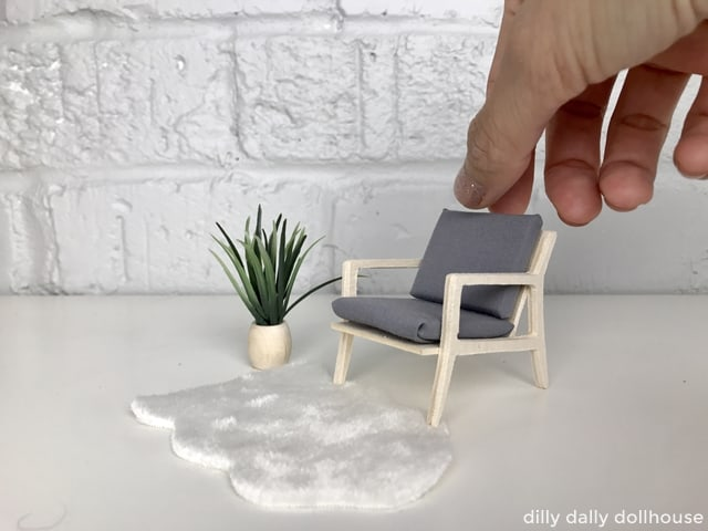 modern dollhouse chair held by hand