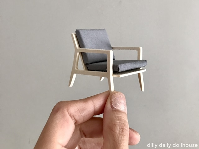 finished modern miniature chair held by hand