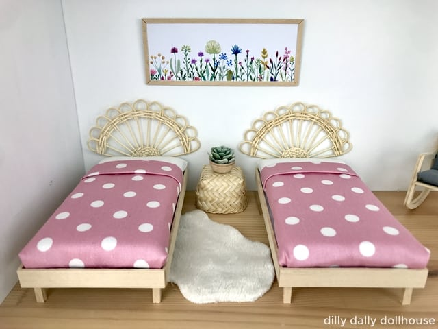 pair of dollhouse beds with boho rattan headboards