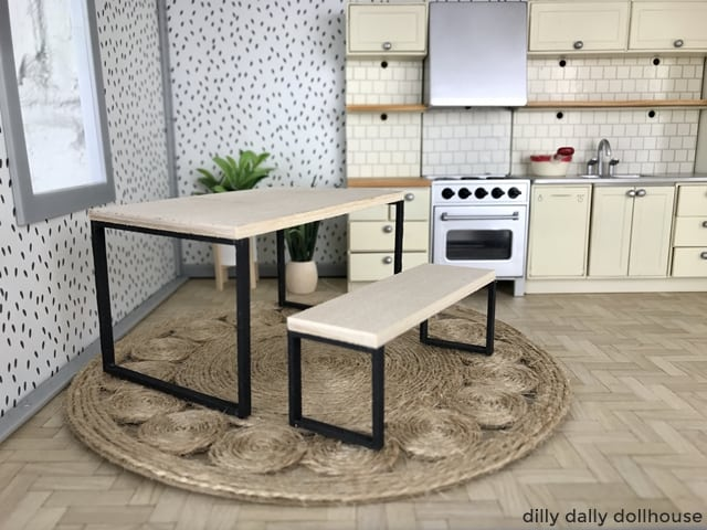 Industrial-style miniature table and bench in dollhouse kitchen scene