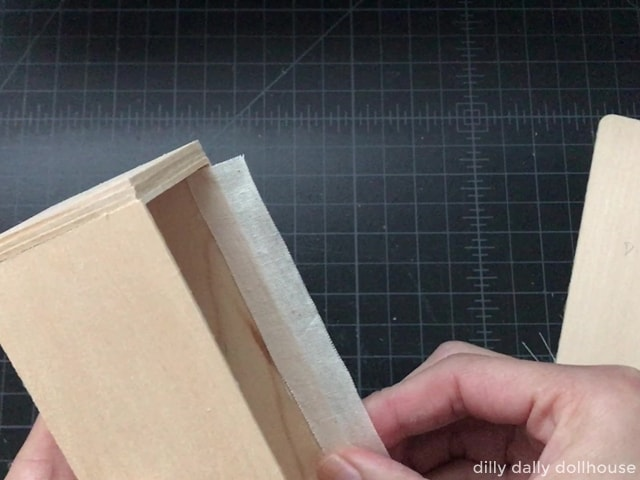 attaching a fabric hinge to the side of the fridge body