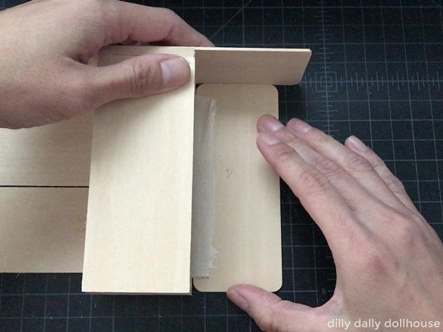 attaching fabric hinge to the door