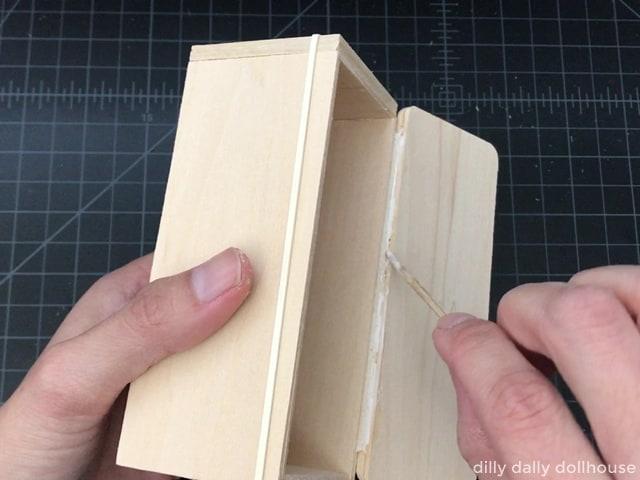 adding glue to fabric hinge