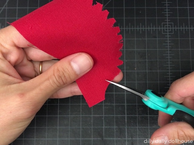 making snips along the curves of fabric